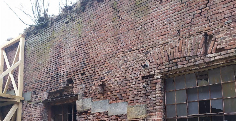 Oprava havarijního stavu hradby za čp. 238